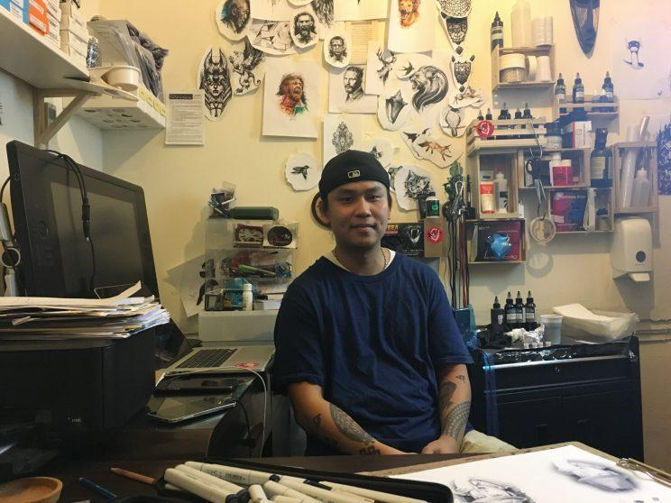 Realism tattoo artist Ael Lim sits at his personal workstation within his tattoo studio, which is located at Pearl's Hill Terrace. He runs Imagine Tattoo Studio. (Photo: Yahoo Lifestyle Singapore).