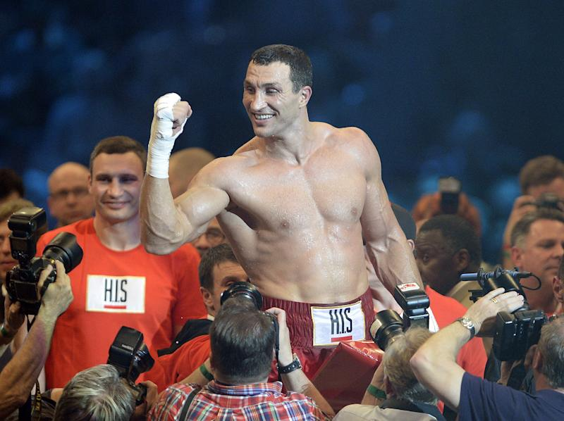 Ukraine's Wladimir Klitschko celebrates after defeating Italy's Fancesco Pianeta during the heavyweight world championship fight in Mannheim, Germany, Saturday, May 4, 2013. Klitschko retained his WBA and IBF heavyweight titles with a sixth-round knockout of Pianeta on Saturday. (AP Photo/Daniel Maurer)
