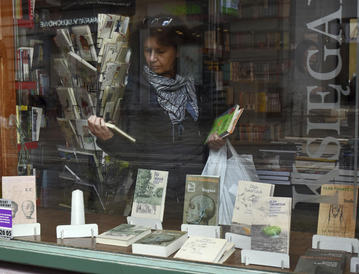 Books written by Olga Tokarczuk are on display in the bookshop of Tokarczuk's publisher Wydawnictwo Lliterackie in Krakow, Poland, Thursday, Oct. 10, 2019. Polish author Olga Tokarczuk and Austrian author Peter Handke won the 2018 and 2019 Nobel Prizes for literature. Two Nobel Prizes in literature were announced Thursday after the 2018 literature award was postponed following sex abuse allegations that rocked the Swedish Academy at that time. (AP Photo/Marek Lasyk)