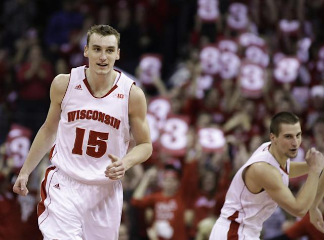 Wisconsin's Sam Dekker (15) and Ben Brust celebrate against Indiana during the second half of an NCAA college basketball game Tuesday, Feb. 25, 2014, in Madison, Wis. Wisconsin won 69-58. (AP Photo/Andy Manis)