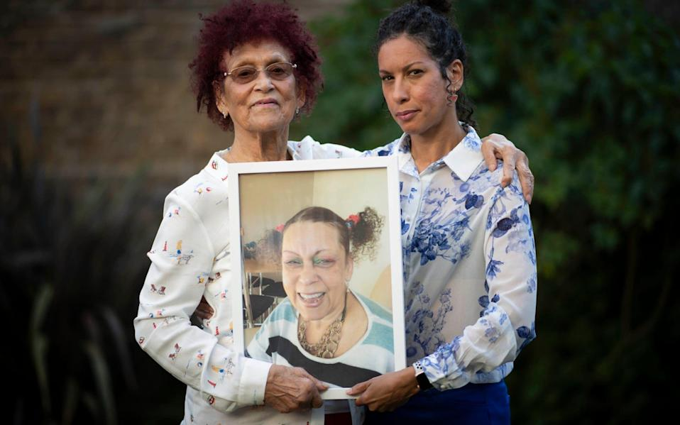 Sally-Rose and her mother Dulceta Cyrille, holding a picture of their late sister and daughter Sonia, who had a DNAR order placed on her - Paul Grover