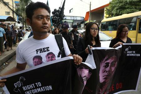 Youth activist Maung Saung Kha (L) leads a march for press freedom in Yangon, Myanmar, September 1, 2018. Picture taken September 1, 2018. REUTERS/Ann Wang