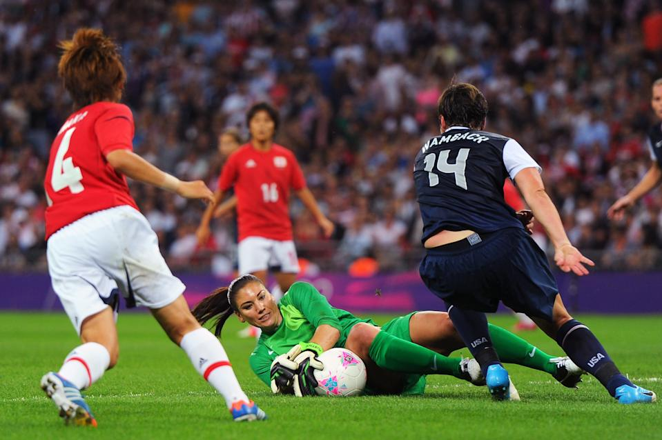 LONDON, ENGLAND - AUGUST 09: Hope Solo #1 of the United States makes a save against Japan during the Women's Football gold medal match on Day 13 of the London 2012 Olympic Games at Wembley Stadium on August 9, 2012 in London, England. (Photo by Michael Regan/Getty Images)