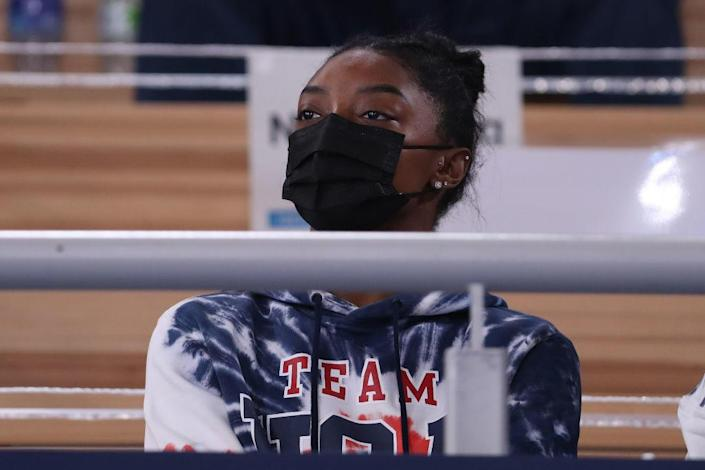 Simone Biles of Team United States watches the Men's All-Around Final on day five of the Tokyo 2020 Olympic Games at Ariake Gymnastics Centre on July 28, 2021 in Tokyo, Japan. / Credit: Abbie Parr / Getty Images
