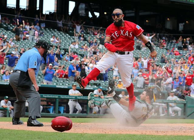 Texas Rangers' Rougned Odor (12) reacts after stealing home in the eighth inning against the Oakland Athletics on Sunday, June 9, 2019 in Arlington, Texas. (Getty Images)