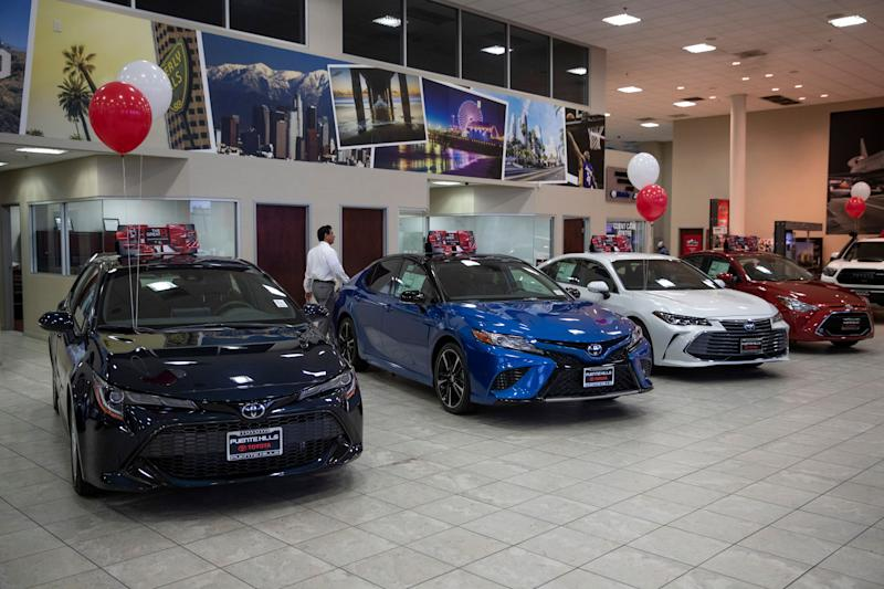 "Toyota sedans are displayed in a showroom at Puente Hills Toyota Thursday, Feb. 14, 2019, in Industry, Calif. If 25 percent tariffs are fully assessed against imported parts and vehicles, and they include Canada and Mexico, the price of imported vehicles would rise more than 17 percent, or around $5,000 each, according to forecasts from IHS Markit. ""I think it would be harmful to the whole economy,"" said Howard Hakes, president of Hitchcock Automotive, which has three Toyota showrooms in metro Los Angeles. (AP Photo/Jae C. Hong)"