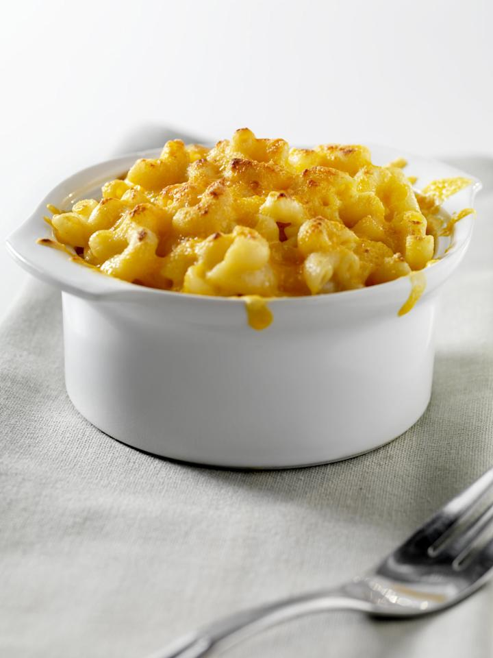 <p>Microwave mac and cheese is pretty simple: make sure the waterline is above the pasta and cook for about three minutes longer than the box's instructions. The key is using a large, deep bowl, because the water will almost definitely boil over if you don't. If all you have is a small bowl, just layer some paper towels underneath to minimize cleanup. The bowl will be HOT, so either use a potholder or wait 10 minutes to remove from the microwave. Strain and add the cheese packet or some cheddar and a splash of milk if you're feeling crafty.</p>