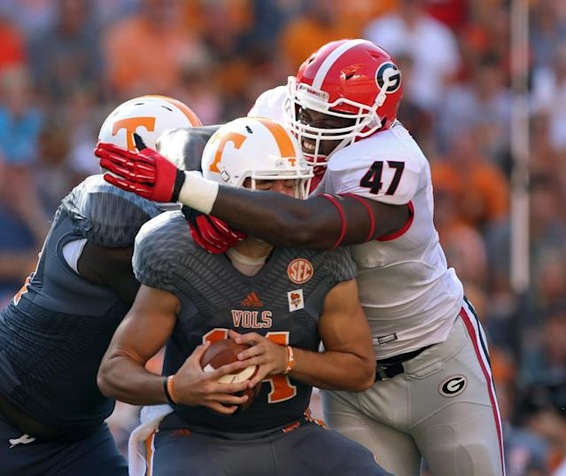 Georgia's Ray Drew (47) sacks Tennessee quarterback Justin Worley (14) during the first half of an NCAA college football game in Knoxville, Tenn., Oct. 5, 2013. (AP Photo/Atlanta Journal-Constitution, Jason Getz)