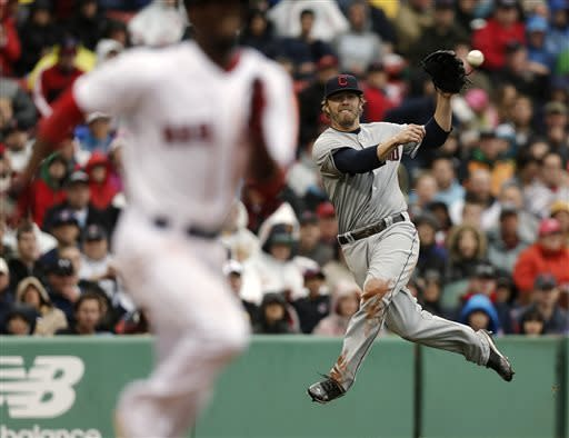 Cleveland Indians third baseman Mark Reynolds, right, makes a throwing error as he tries to get out Boston Red Sox's Pedro Ciriaco on a bunt during the sixth inning of a baseball game at Fenway Park in Boston, Saturday, May 25, 2013. (AP Photo/Winslow Townson)