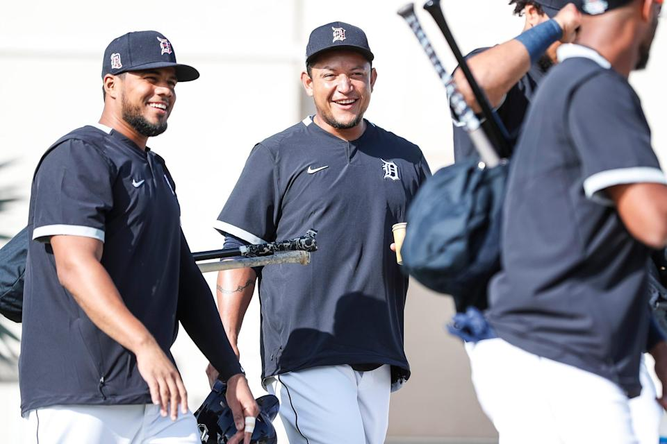 Miguel Cabrera, center, talks to third baseman Jeimer Candelario, left, as they walk towards the field during Detroit Tigers spring training at TigerTown in Lakeland, Fla., Monday, Feb. 17, 2020.