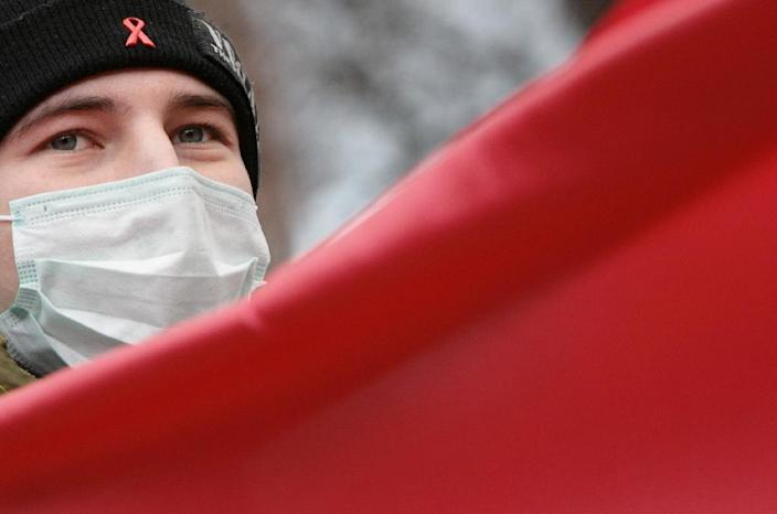 A Russian FrontAIDS with a Red Ribbon, a sign of support for people living with HIV on his cap protests in downtown Moscow on November 28, 2006 (AFP Photo/Denis Sinyakov)