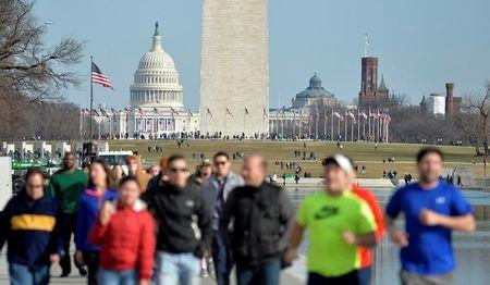 Tourists and visitors crowd The Mall in pre-inaugural Washington DC