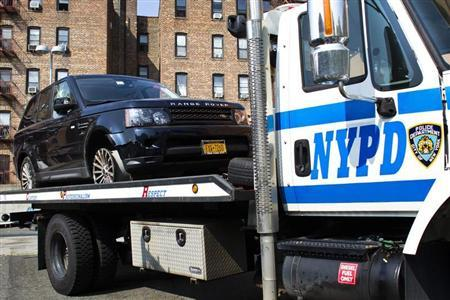 The SUV involved in Sunday's Manhattan's Henry Hudson Parkway motorcycle accident is seen on a NYPD truck arriving to the 33 precinct in New York