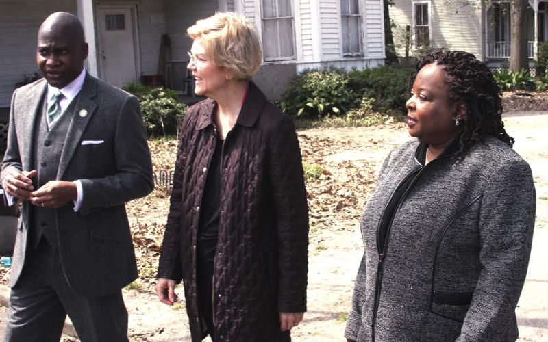 From left, Greenville, Miss. Mayor Errick Simmons, 2020 Democratic presidential candidate Sen. Elizabeth Warren and Mable Starks, former CEO Mississippi Action for Community Education, tour Central Avenue from Poplar Street in Greenville, Miss., Monday  March 18, 2019. The group discussed dilapidated and affordable housing in the rural communities. (Bill Johnson/The Democrat-Times via AP)
