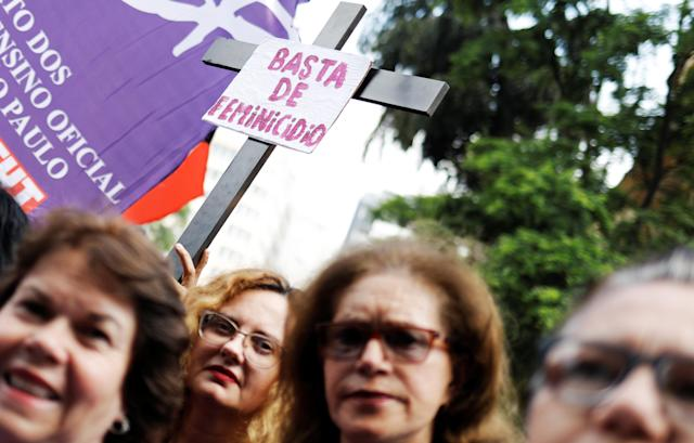 "<p>A crosss with a sign reading ""Enough of Femicide"" is pictured next to women during the rally on the World Day for the Elimination of Violence against Women in Sao Paulo, Brazil, Nov. 25, 2017. (Photo: Nacho Doce/Reuters) </p>"