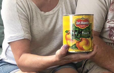 Eileen O'Brien shows the canned peaches that she delivered, to underscore her support for impeachment, to the office of her U.S. House of Representative, at her home in Clearwater, Florida, U.S., April 18, 2019.   REUTERS/Letitia Stein