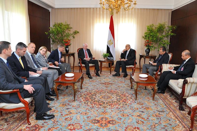 This image released by the Egyptian Presidency shows interim Vice President Mohamed Elbaradei, center right, meeting with U.S. senators John McCain, center left, and Lindsey Graham, fifth from left, with U.S. Ambassador to Egypt Anne Patterson, fourth from left, in Cairo, Egypt, Tuesday, Aug. 6, 2013. U.S. senators John McCain and Lindsey Graham arrived in Cairo on Monday at President Barack Obama's request to press senior Egyptians for a quick return to civilian rule. (AP Photo/Egyptian Presidency)