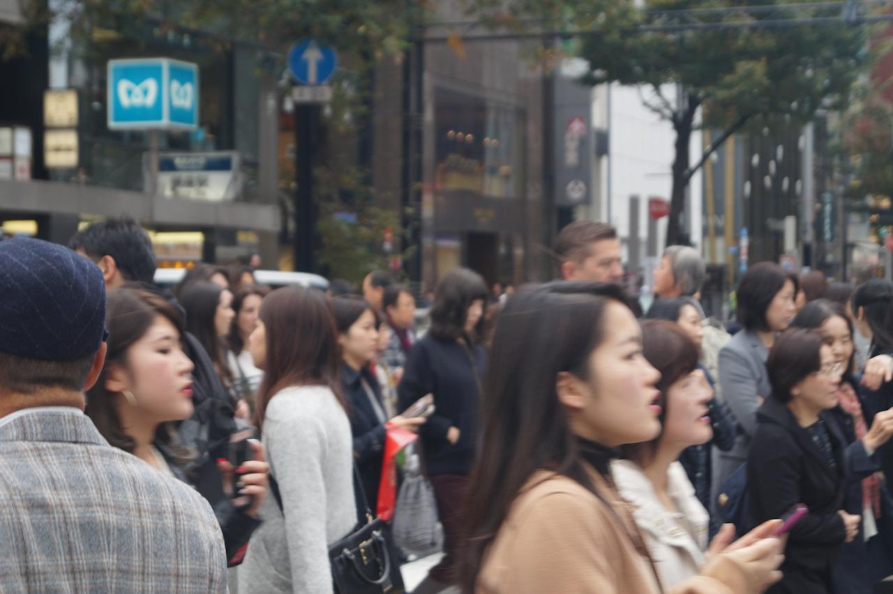 <p>Shoppers and other pedestrians stroll through Tokyo's fashionable Ginza district, which has many upscale stores and restaurants. (Photo: Michael Walsh/Yahoo News) </p>