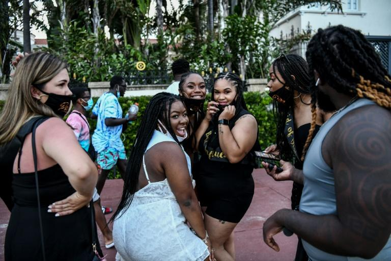 A group of women dance as they celebrate a bachelorette party on Ocean Drive in Miami Beach, Florida on June 26, 2020, as the state records a surge in new coronavirus infections -- mainly among young people (AFP Photo/CHANDAN KHANNA)