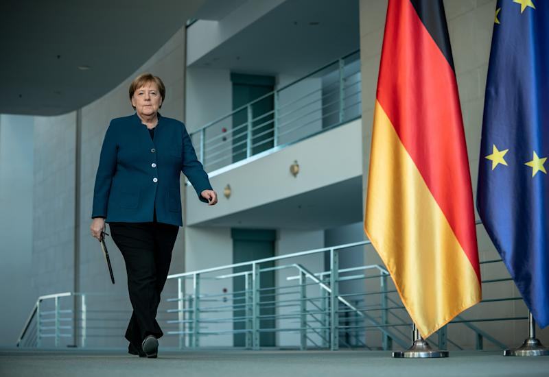 German Chancellor Angela Merkel arrives to make a press statement on the spread of the new coronavirus COVID-19 at the Chancellery, in Berlin on March 22, 2020. - German Chancellor Angela Merkel is going in to quarantine after meeting virus-infected doctor according to her spokesman on March 22, 2020. (Photo by Michael Kappeler / AFP) (Photo by MICHAEL KAPPELER/AFP via Getty Images)