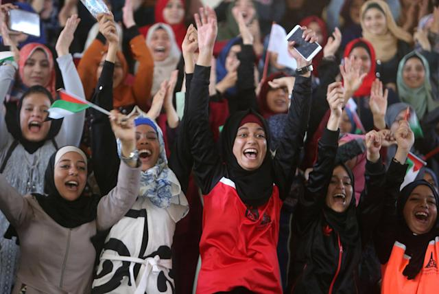 Female Palestinian students cheer as they watch a local volleyball competition at al-Alqsa university in Khan Younis in the southern Gaza Strip October 26, 2017. REUTERS/Ibraheem Abu Mustafa