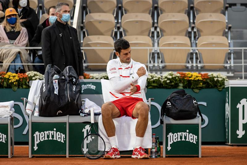 PARIS, Oct. 7, 2020 -- Novak Djokovic of Serbia takes a rest during the men's singles quarterfinal match against Pablo Busta of Spain at the French Open tennis tournament 2020 at Roland Garros in Paris, France, Oct. 7, 2020. (Photo by Aurelien Morissard/Xinhua via Getty) (Xinhua/Aurelien Morissard via Getty Images)