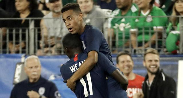 "Tyler Adams celebrates with teammate <a class=""link rapid-noclick-resp"" href=""/soccer/players/1482544/"" data-ylk=""slk:Timothy Weah"">Timothy Weah</a> after scoring for the United States against Mexico. (AP)"