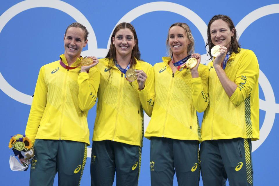 Australia's women's 4x100m women's relay team, Meg Harris, Bronte Campbell, Emma McKeon and Cate Campbell celebrate on the podium at the 2020 Summer Olympics, Sunday, July 25, 2021, in Tokyo, Japan. (AP Photo/Matthias Schrader)