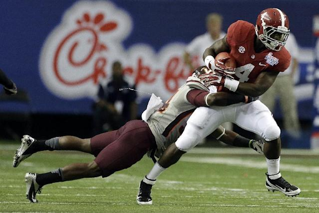 Virginia Tech safety Kyshoen Jarrett (34) tackles Alabama running back T.J. Yeldon (4)in the first half of an NCAA college football game, Saturday, Aug. 31, 201, in Atlanta. (AP Photo/Dave Martin)
