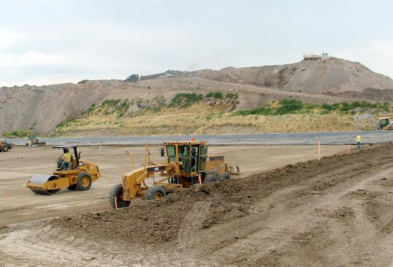 In this August 2012 photo provided by the North Dakota Health Department workers  expand a special landfill for oilfield waste near Sawyer, N.D.  State Health Department data show the  amount of so-called oilfield special waste has increased nearly 5,100 percent in the past decade, to more than 512,000 tons last year. Health officials say more than a dozen special landfills are proposed to keep pace with the state's booming oil production. (AP Photo/Courtesy North Dakota Health Department)