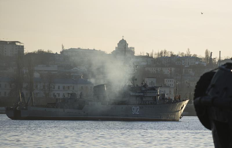 """Russian navy ship minesweeper """"Turbinist"""" is seen at harbor of Sevastopol, Ukraine, Monday, March 3, 2014. The Ukrainian Defense Ministry said that Russian forces that have overtaken Ukraine's strategic region of Crimea are demanding that the ship's crew surrender. (AP Photo/Andrew Lubimov)"""