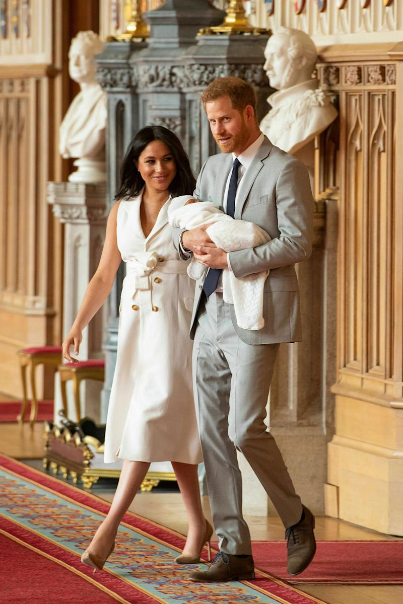 Britain's Prince Harry and Meghan, Duchess of Sussex, arrive for a photocall with their newborn son, in St George's Hall at Windsor Castle, Windsor, south England, Wednesday May 8, 2019. Baby Sussex was born Monday at 5:26 a.m. (0426 GMT; 12:26 a.m. EDT) at an as-yet-undisclosed location. An overjoyed Harry said he and Meghan are