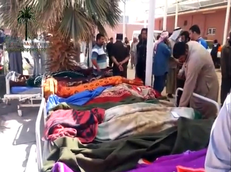 This citizen journalist image provided by the Rebels Gathering of Hawija on the group's Facebook page shows people inspecting protesters' dead bodies at a hospital in Hawija, 150 miles (240 kilometers) north of Baghdad, Iraq. Iraqi security forces backed by helicopters raided a Sunni protest camp before dawn Tuesday, prompting clashes that killed at least 36 people in the area and significantly intensified Sunni anger against the Shiite-led government. (AP Photo/Rebels Gathering of Hawija)