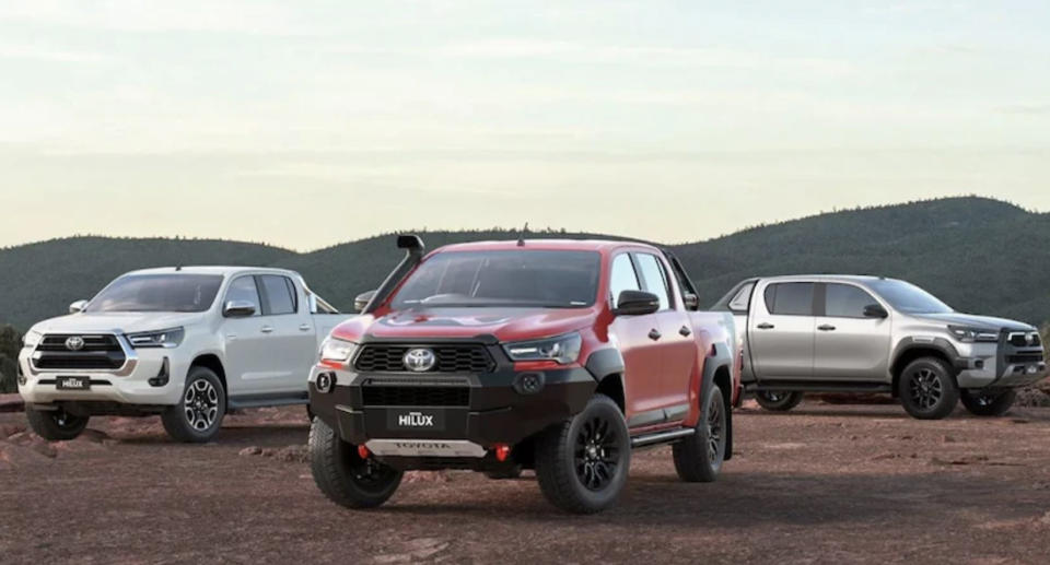 Toyota Hilux utes are pictured.