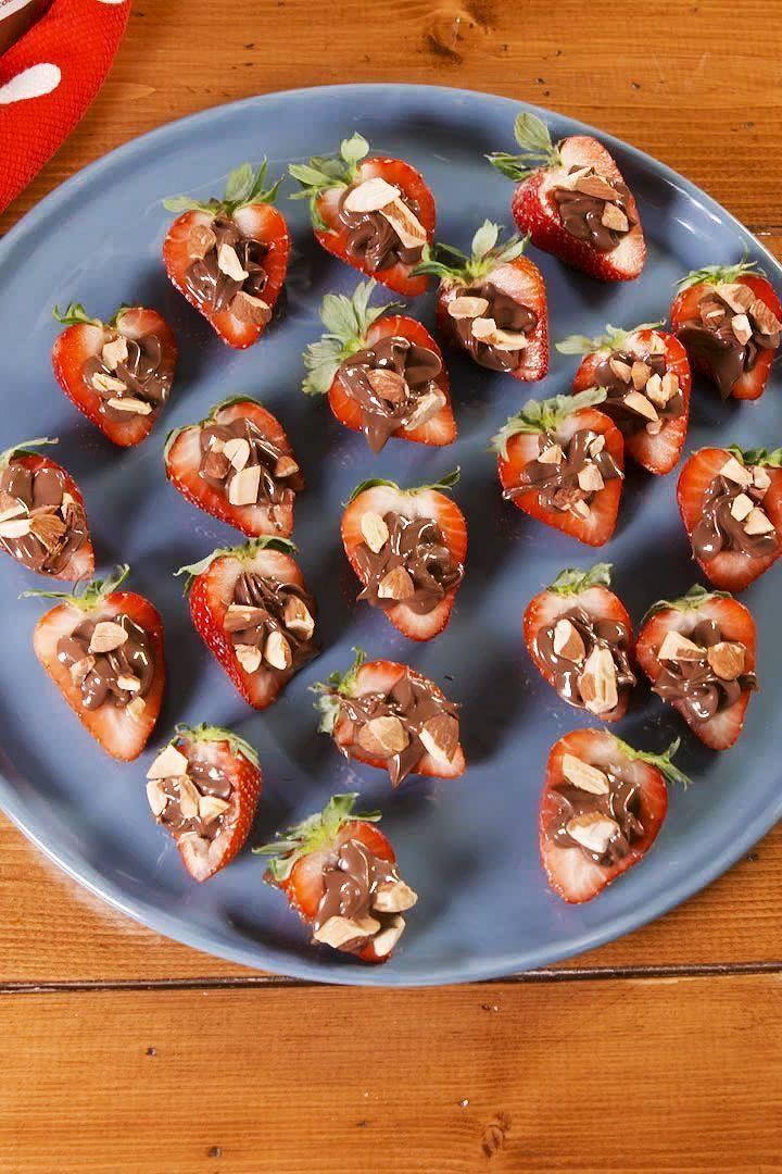 """<p><a href=""""https://www.delish.com/uk/cooking/recipes/a29955174/chocolate-cuties-recipe/"""" rel=""""nofollow noopener"""" target=""""_blank"""" data-ylk=""""slk:Chocolate dipped fruit"""" class=""""link rapid-noclick-resp"""">Chocolate dipped fruit</a> is so last year. These little guys are for the Nutella lover in your life. </p><p>Get the <a href=""""https://www.delish.com/uk/cooking/recipes/a30775545/nutella-stuffed-strawberries-recipe/"""" rel=""""nofollow noopener"""" target=""""_blank"""" data-ylk=""""slk:Nutella Stuffed Strawberries"""" class=""""link rapid-noclick-resp"""">Nutella Stuffed Strawberries</a> recipe.</p>"""