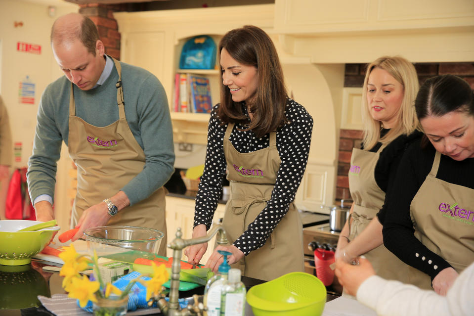 The Duke and Duchess of Cambridge prepare soup with members and staff in the kitchen area during a visit to Extern at Savannah House, in County Meath, near Dublin, as part of their three day visit to the Republic of Ireland.