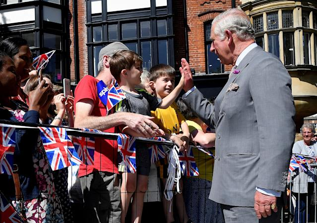 Britain's Prince Charles 'high-fives' a well-wisher during visit to Salisbury in southwest Britain, June 22, 2018. REUTERS/Toby Melville TPX IMAGES OF THE DAY