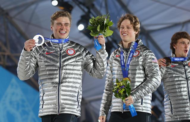 SOCHI, RUSSIA - FEBRUARY 13: (L-R) Silver medalist Gus Kenworthy of the United States, gold medalist Joss Christensen of the United States and bronze medalist Nicholas Goepper of the United States celebrates during the medal ceremony for the Freestyle Skiing Men's Ski Slopestyle on day six of the Sochi 2014 Winter Olympics at Medals Plaza on February 13, 2014 in Sochi, Russia. (Photo by Quinn Rooney/Getty Images)