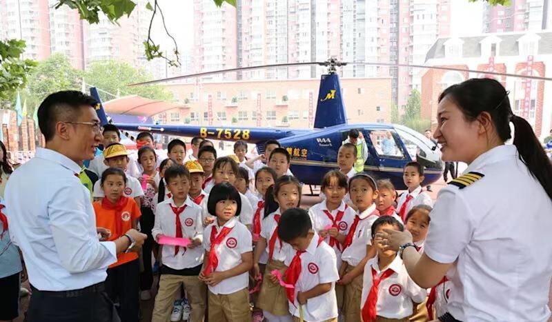 Chinese father decides to drop in on daughter's school … via helicopter