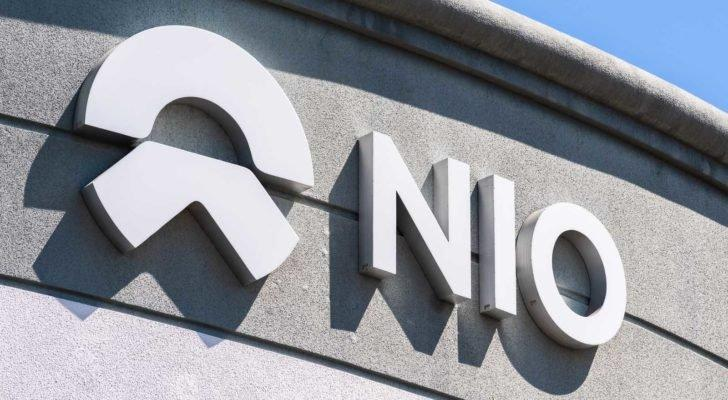 Image of Nio (NIO) logo branded on the exterior of a corporate building.