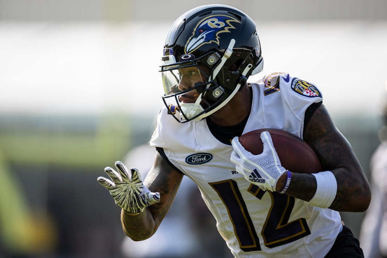 Rashod Bateman #12 of the Baltimore Ravens participates in a drill during training camp at Under Armour Performance Center Baltimore Ravens on July 28, 2021 in Owings Mills, Maryland. (Photo by Scott Taetsch/Getty Images)
