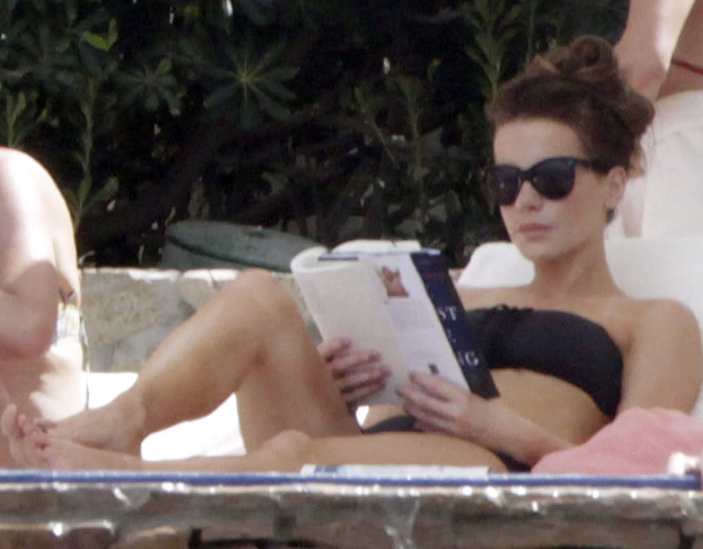 Swimming, schmimming. Kate Beckinsale was focused on finally finishing that book when she and her fam spent Easter in Los Cabos earlier this year. (3/29/2013)