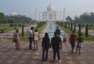 A small number of tourists visit as the Taj Mahal monument is reopened after being closed for more than six months due to the coronavirus pandemic in Agra, India, Monday, Sept.21, 2020. (AP Photo/Pawan Sharma)