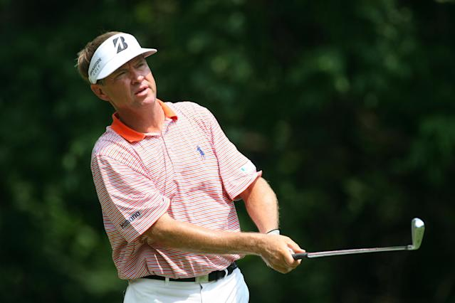 GREENSBORO, NC - AUGUST 18: Davis Love III watches his tee shot on the fourth hole during the third round of the Wyndham Championship at Sedgefield Country Club on August 18, 2012 in Greensboro, North Carolina. (Photo by Hunter Martin/Getty Images)