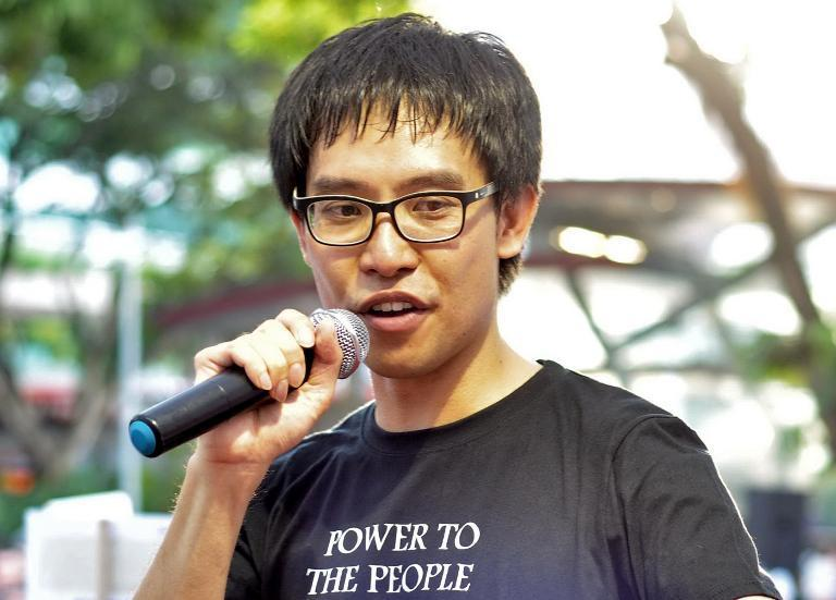 Roy Ngerng, a blogger, speaks at speakers corner during a rally to demand reforms in the country's pension system in Singapore on June 7, 2014
