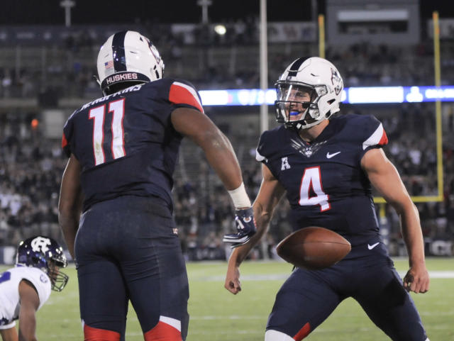 After trailing 20-7 at halftime, UConn came back to beat Holy Cross, 27-20. (AP Photo/Stephen Dunn)