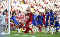 Chelsea's Reece James, second left, handballs on the goal line which results in a red card and a penalty given to Liverpool during the English Premier League soccer match between Liverpool and Chelsea at Anfield, Liverpool, England, Saturday, Aug. 28, 2021. (Mike Egerton/PA via AP)