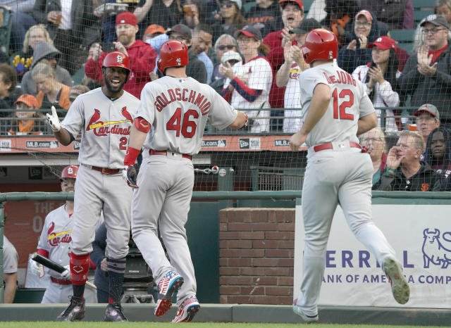 St. Louis Cardinals' Paul Goldschmidt (46) is congratulated by Dexter Fowler, left, after hitting a two-run home run against the San Francisco Giants during the first inning of a baseball game in San Francisco, Friday, July 5, 2019. Paul DeJong (12) scored. (AP Photo/Tony Avelar)