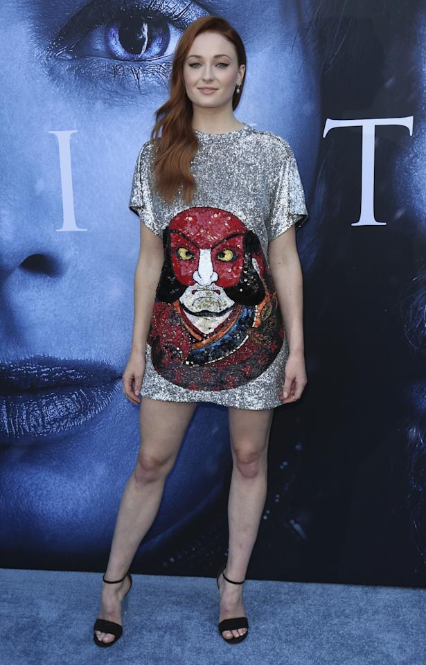 <p>The new face of Louis Vuitton naturally chose a sequinned dress with a face on the front by the French label. (Photo: AP) </p>