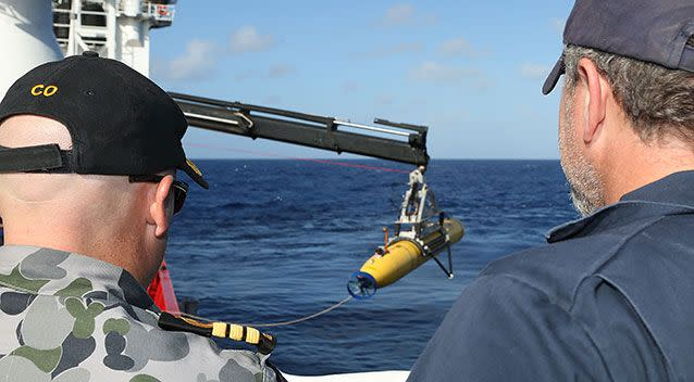 Australian search teams deploy an underwater search vehicle in 2014. Source: Getty Images